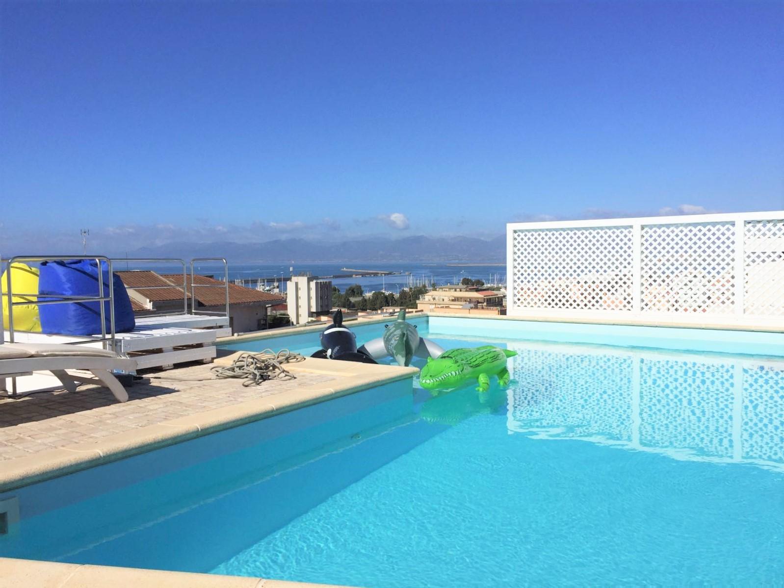 Bonaria attico panoramico con piscina house experience - Attico con piscina ...